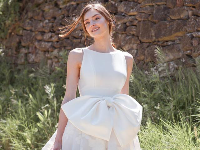 Estos son los 50 vestidos con moños para novia que no te puedes perder