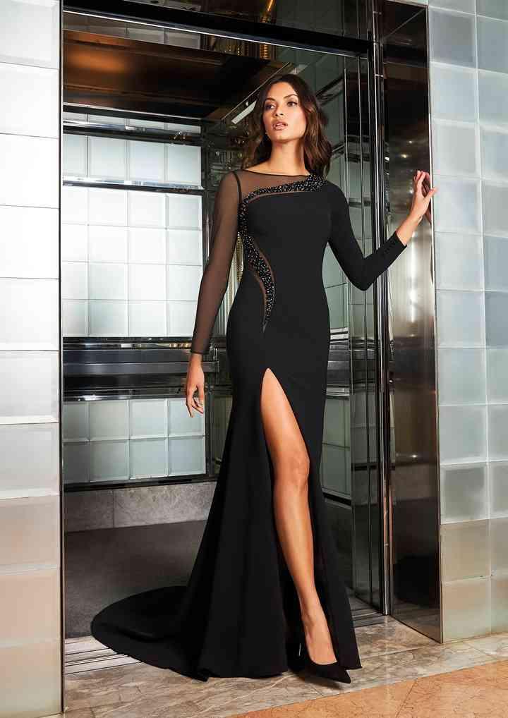 vestido de fiesta negro largo con mangas y transparencia