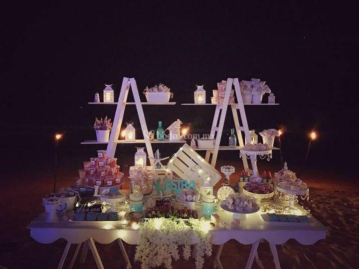 Mesa de dulces iluminada