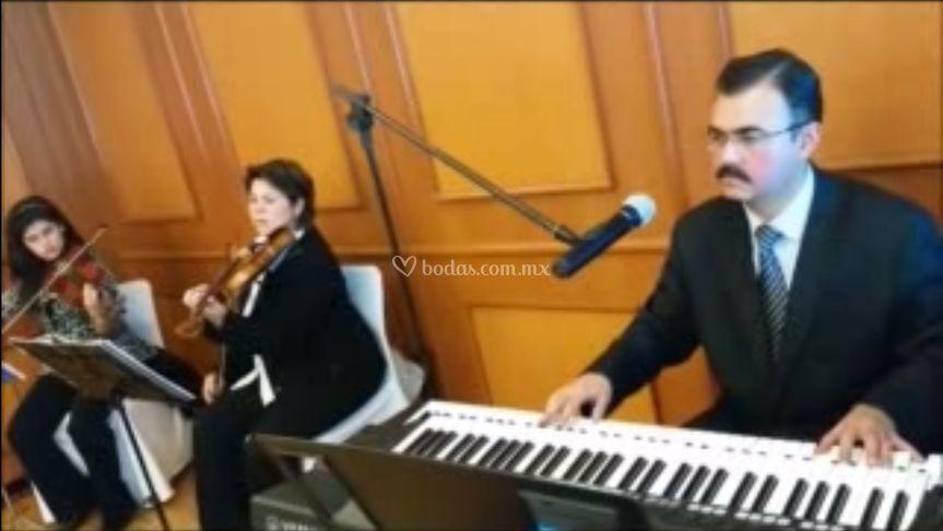 Dueto de violines con piano