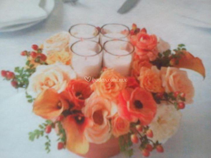 Centro de mesa velas flores