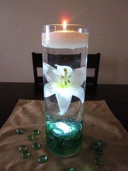 arreglos de mesa con agua y velas